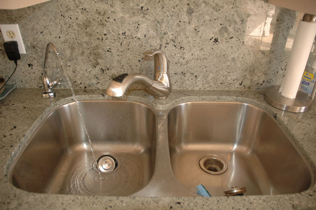 Stainless steel sink and faucet plus built in water filtration system